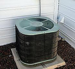Shown here is a dryer vent placed too closely to the outdoor unit.